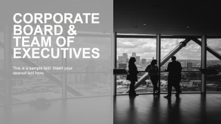 Executives with Night Skyline View